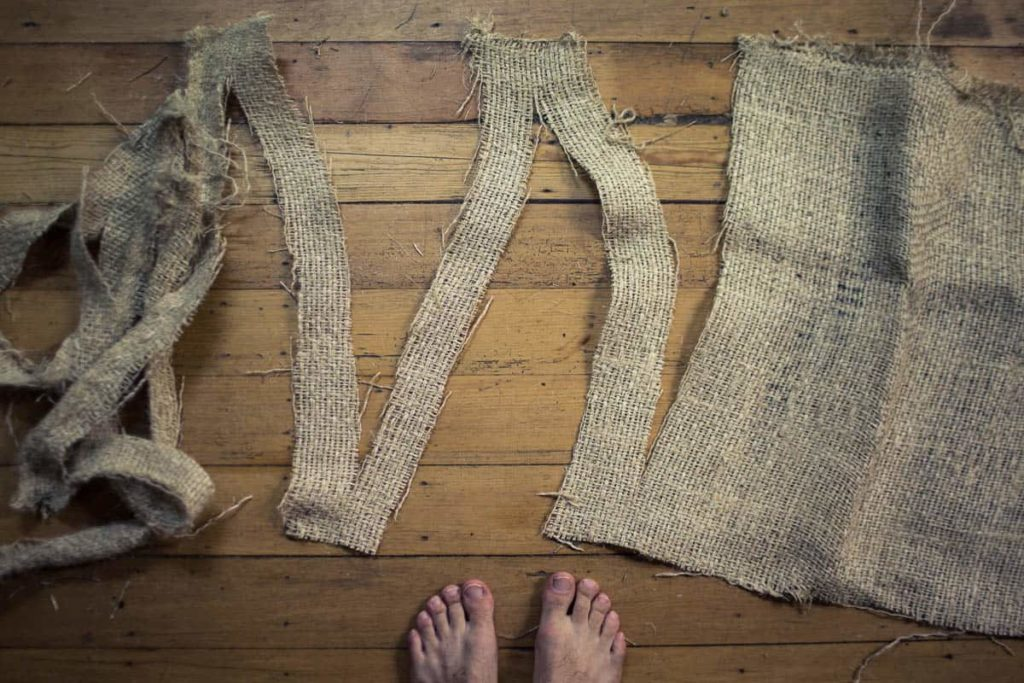Work in progress – cutting weaving strips from coffee bean hessian sacks,  Chris Johnston, Suspension Expresso