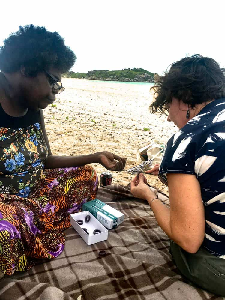 Marrnyula Mununggurr works with Melinda Young on her rings at Galaru