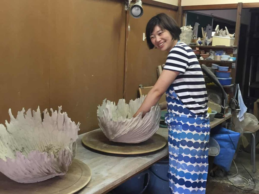 Michiko Hashimoto, checking how dry they are after carving them