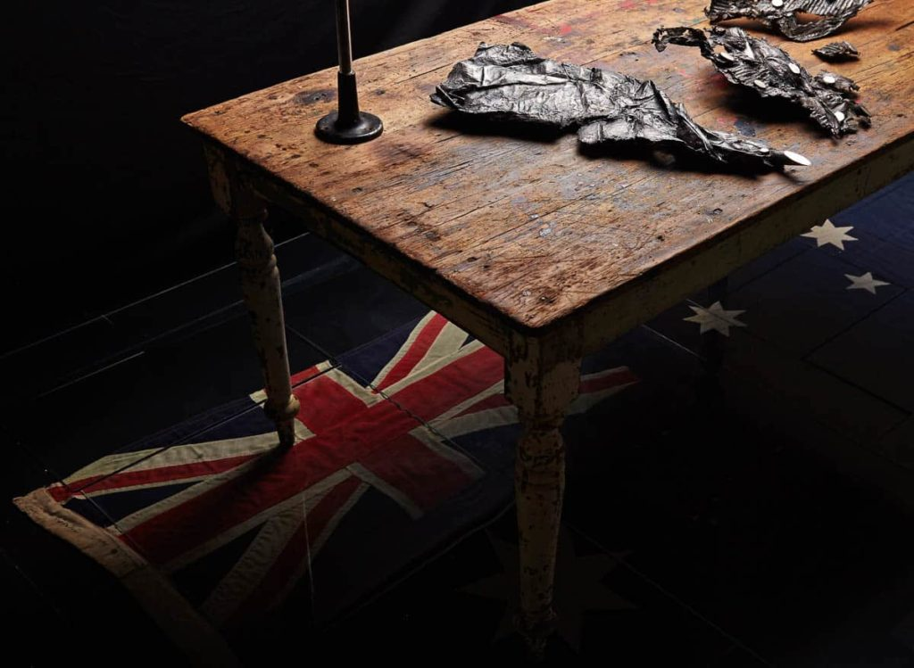 Louiseann King, arbor temporis momentum - chartam, 2017, bronze, vintage scientific glass tubes, early Australian pine table, vintage steel stand, vintage cotton handmade Australian flag, vintage window glass, Image courtesy of the artist, photo: Danny Wootton
