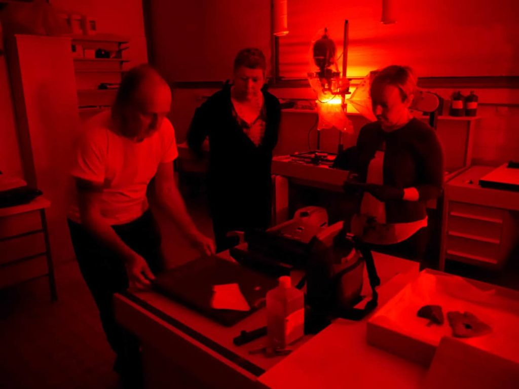 Mark Adams, Areta Wilkinson, Julie Adams making photograms. Museen Dahlem Sudsee Store, Berlin, 2015