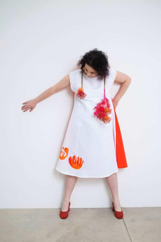 Lauren Simeoni, Protea neckpiece, 2017, artificial foliage, brass, beads, thread, paint; Protea dress, long white + red Linen-cotton, Hand cut stencil print, one-off, photo: Craig Arnold