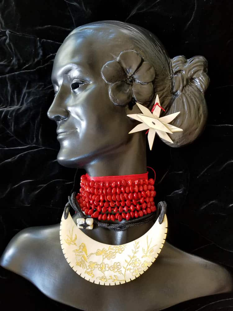 Sofia Tekela-Smith, Melodies of their Honey Coloured Skin, 2003, (revisited 2017) self portrait, sihouette is fibreglass and automotive paint. It is adorned with gold lip mother of pearl necklace, gold leaf, waxed thread, diridamu seed, Gold lip mother of pearl hairpin, black pearl (Manihiki), South Seas pearl