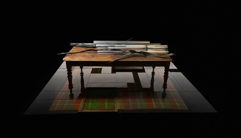 Louiseann King, arbor temporis momentum - cortex, 2017, bronze, vintage glass industrial tubes, Australian Sheoak & White Cedar Colonial Table, vintage Australian wool blanket, vintage patterned coloured glass windows, vintage window glass, Image courtesy of the artist. Photo: Danny Wootton