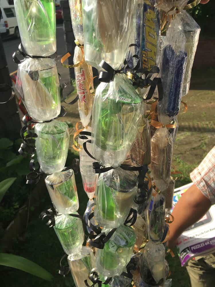 Charlotte Taele Seymour Atiga and Seini Fatafehi Nofo'i Lelenga Lātū, Ula lole (lolly ula), 2016, chocolates, miniature bottles of alcohol, plastic, ribbon, model: Hikule'o Fe'amoeako 'i Kenipela Melaia Māhina