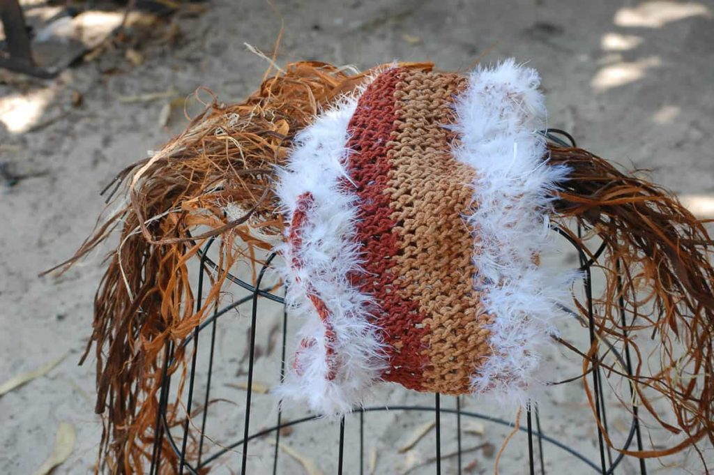 Batumbil Burarrwanga feathers and sacred string weaving