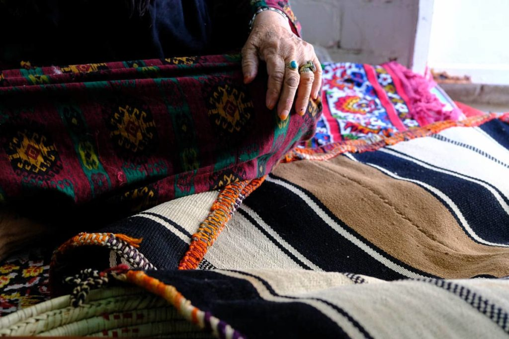 Detail of sadu weaving: the band is called the shajarah and is the most intricate part of the weaving. The symbols depict the personal journey of the weaver and include such symbols as water puddles, goats, and earrings.