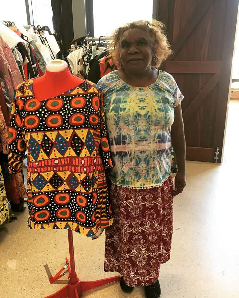 Cynthia Multa with her garment created with her fabric design, photo by Brigida Stewart/Batchelor Institute of Indigenous Tertiary Education