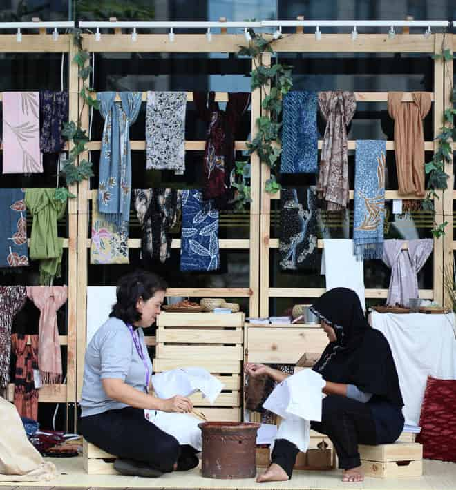 During exhibition in Jakarta, Indonesia, the artisan is also showing handmade Batik demonstration