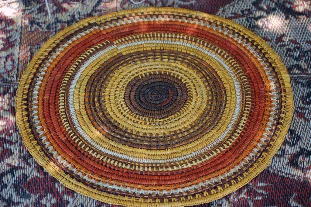 Batumbil Burarrwanga, mat with natural dyes, orange, yellow, brown natural dyes