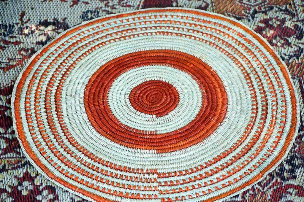 Batumbil Burrarwanga, mat with orange and undyed pandanus fibres.