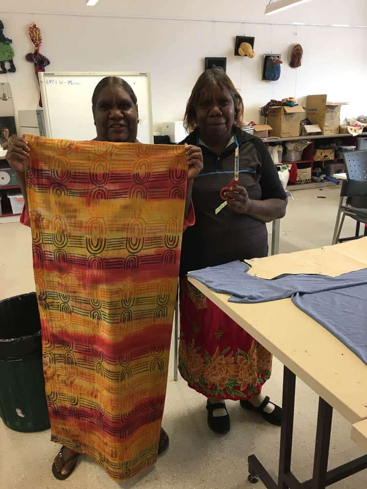 Lisa Multa with her master cloth in shibori dye and fabric pastels and Kelly Dixon, photo by Brigida Stewart/Batchelor Institute of Indigenous Tertiary Education
