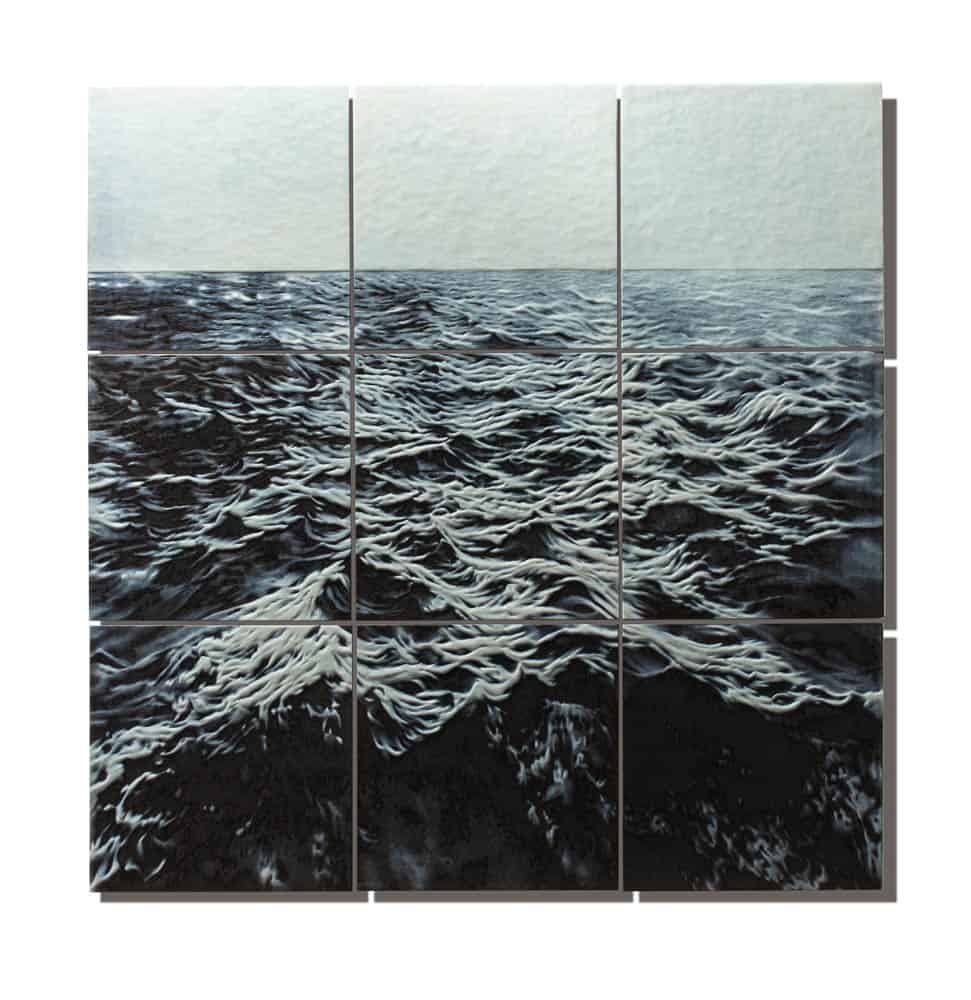 April Surgent, The unnatural movement of the ocean with plastic, 2017, cameo engraved glass, 30 × 30 × .75 inches