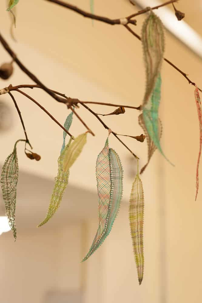 Members of the Victorian Branch of the Australian Lace Guild and community participants coordinated by Lindy de Wijn,  Leaves of Lace (installation image) 2017  Threads (silk, cotton, linen, wool), found wood and fishing line.  Dimensions variable  Courtesy of the artists