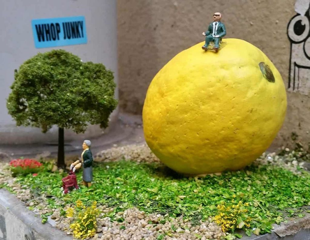 Tinky, 'After things turned sour and Marj ended their relationship George felt he's lost his zest for life - it was time he found a new squeeze, 2018, ceramic lemon, miniature figurines, faux grass, 20cmx20cm15cm, photo: liz sonntag