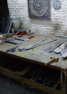 Work bench with tin pieces in progress 2013 photo Claire McArdle
