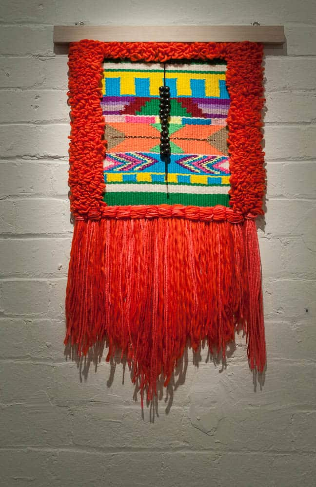 Yunuen Perez, A Warrior´s Shield, 2018, handwoven tapestry, yarn, wool, black clay beads
