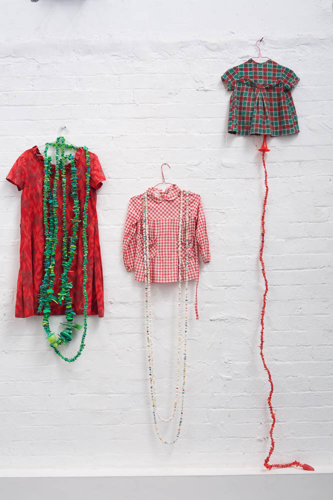 Rox De Luca, Mama's dress, The smock, Red/green/black/white dress, 2018 Clothing c.1960s, found plastic, wire, garlands of various dimensions, photo: Ian Hobbs