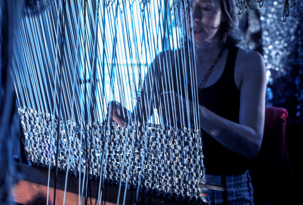 Margaret Grafton at the loom weaving with metal