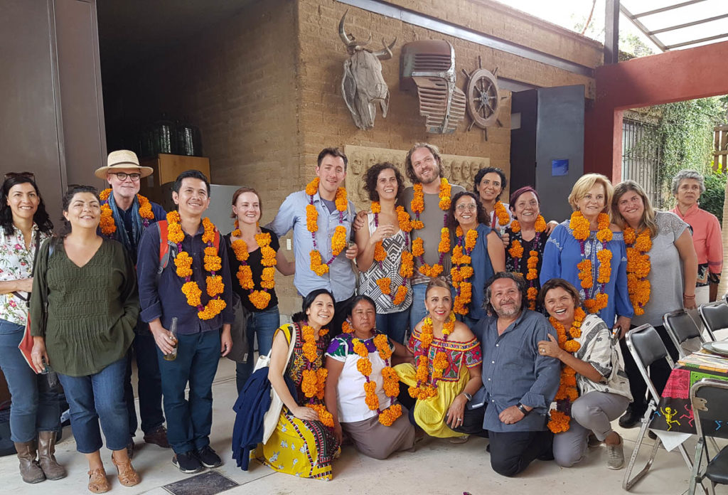 Participants in Garland's event in Oaxaca after being garlanded at the studio of Aden Paredes.