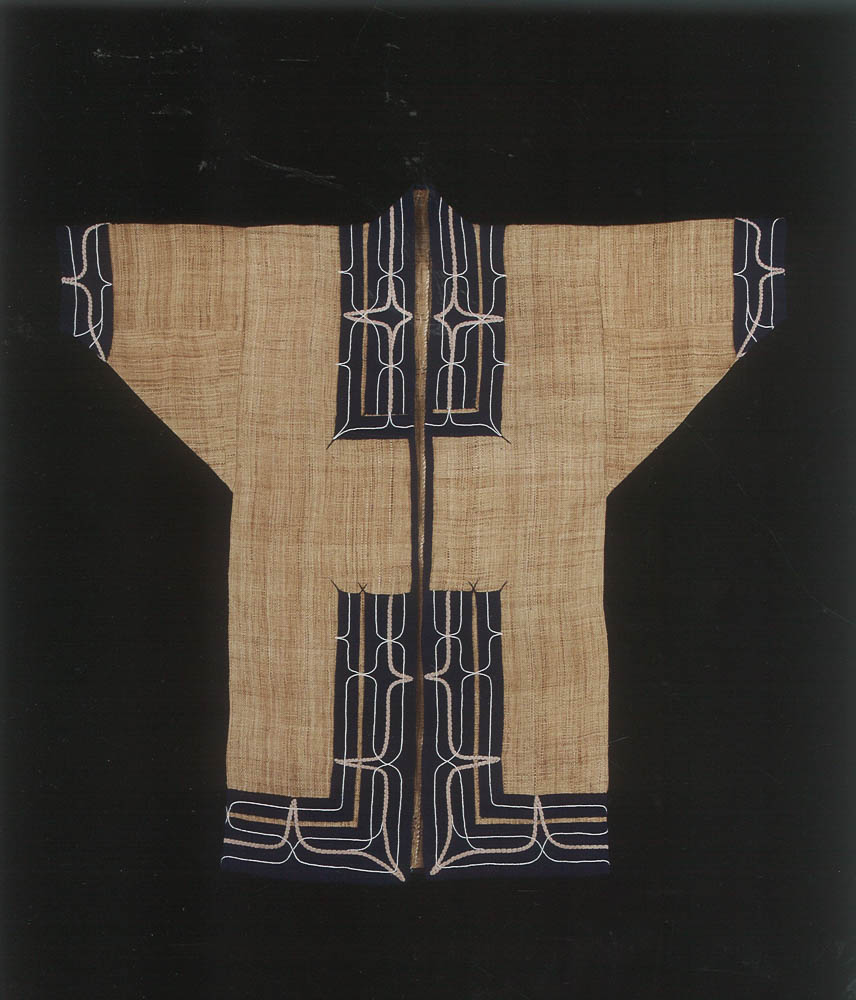 """Reproduction of an Ainu attus (woven elmbast fibre robe) from the Hokkaido University Museum collection, produced for the """"Handprints of Our Ancestors exhibit"""" (2009). Replica woven and embroidered by artist Uetake Yasuko (quoted in the chapter excerpt)."""