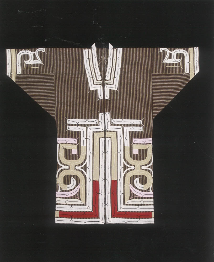 """Reproduction of an Ainu ruunpe (cotton appliqued robe) from the Hokkaido University Museum collection, produced for the """"Handprints of Our Ancestors exhibit"""" (2009). Replica woven and embroidered by artist Yamamoto Miiko (quoted in the chapter excerpt)."""