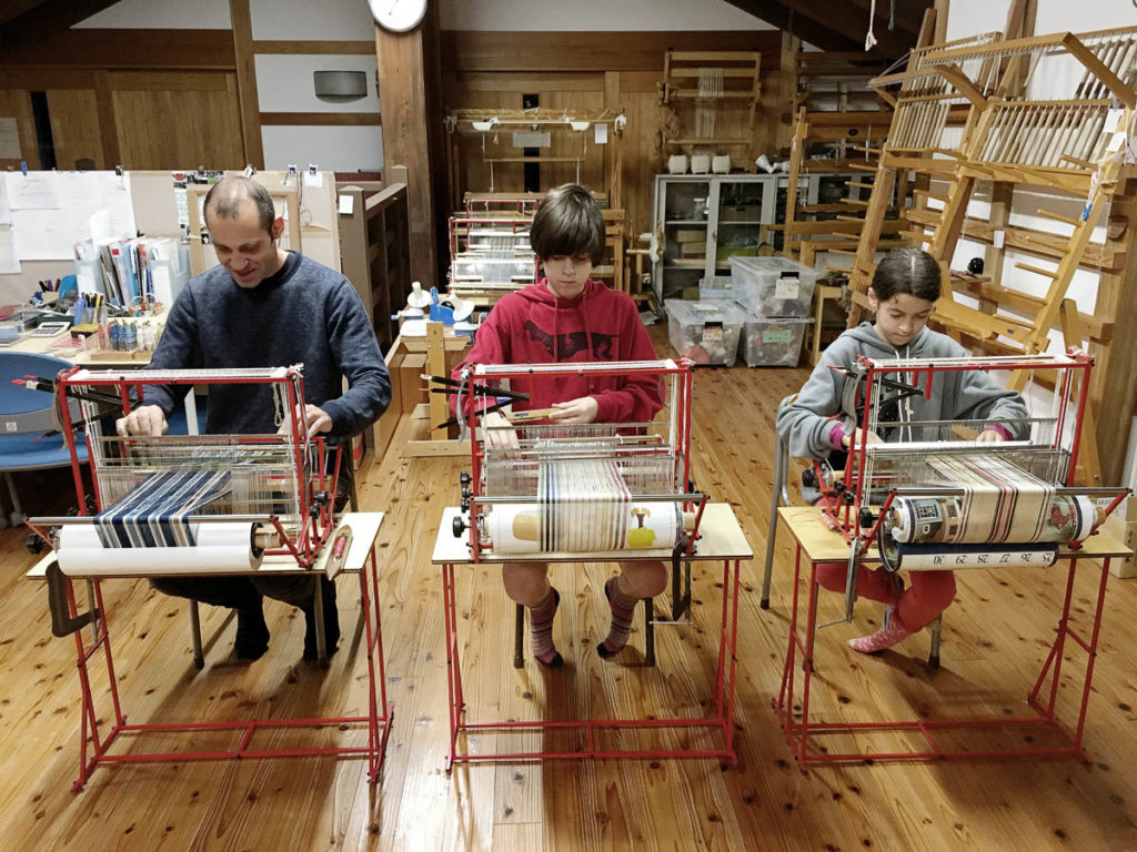 Paul, Oli and Luella in a weaving workshop. Image credit: Siri Hayes