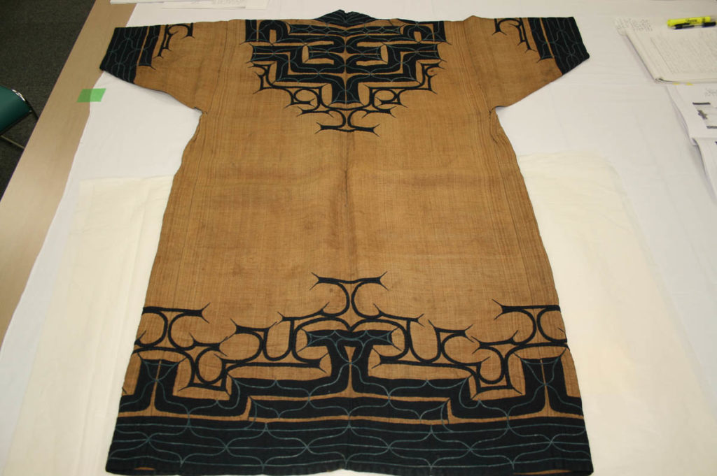 """Use of very large tsuno-tokki on this robe indicate a strong prayer to protect and even ward off the potential of attack by payoka kamuy (deity of smallpox) and by Wajin men, who were known for sexually colonizing Ainu women, i.e. sexual assault and then taking them as """"genchi tsuma"""" or as Ezo wives (Tenri Sankokan Museum collection)"""